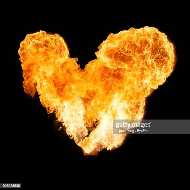close-up of heart shape bonfire against black background - utomhuseld bildbanksfoton och bilder