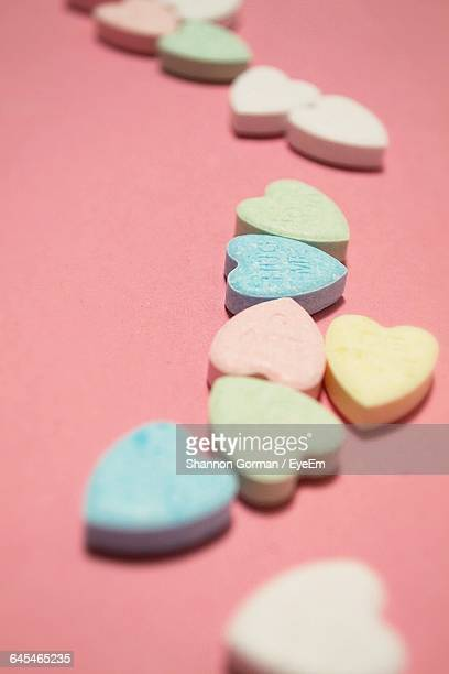 Close-Up Of Heart Shape Candy On Pink Background