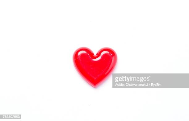 Close-Up Of Heart Shape Candy On White Background