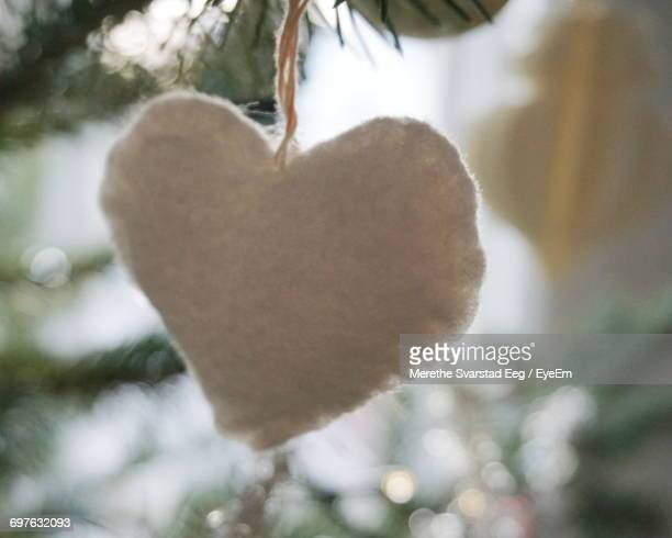 Close-Up Of Heart Shape Decoration Hanging From Christmas Tree