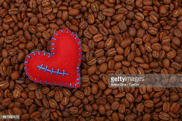 Close-Up Of Heart Shape Decoration Over Roasted Coffee Beans