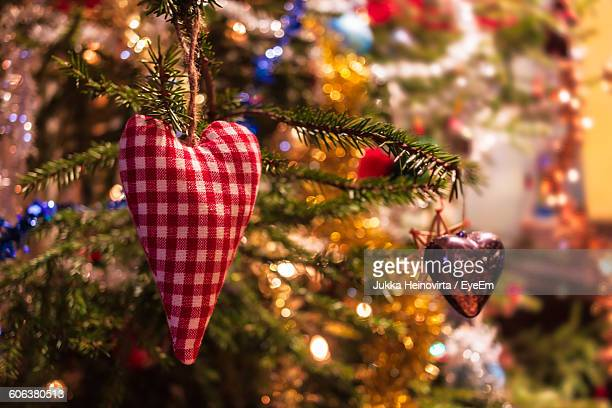 close-up of heart shape decorations hanging on christmas tree - heinovirta stock pictures, royalty-free photos & images