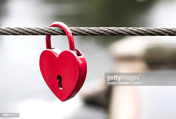 Close-Up Of Heart Shape Love Lock Hanging On Rope