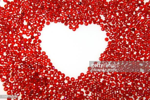 close-up of heart shape made with beads against white background - bead stock pictures, royalty-free photos & images