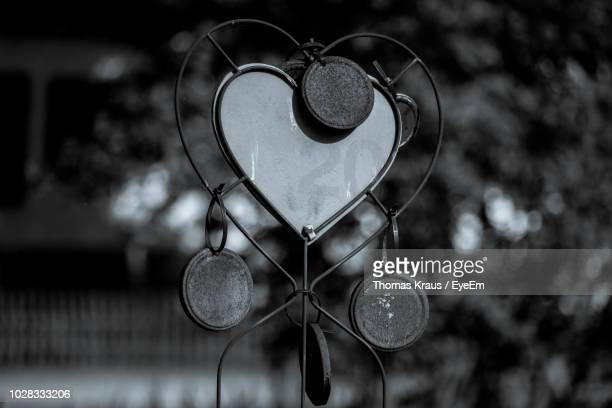 Close-Up Of Heart Shape Metallic Decoration Outdoors