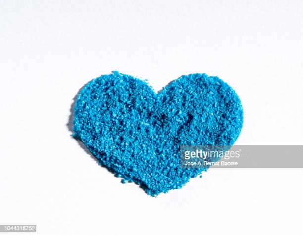 Close-Up Of Heart Shape of a light blue color on a white background.