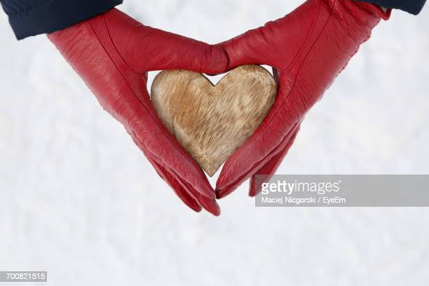 close-up of heart shape on hand - leather glove stock pictures, royalty-free photos & images