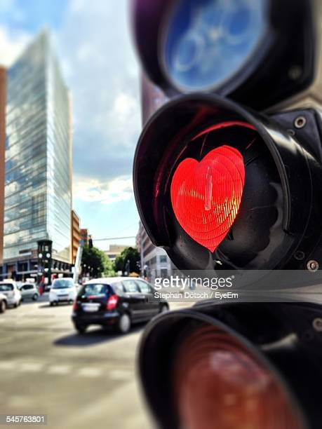 Close-Up Of Heart Shape On Road Signal By Street