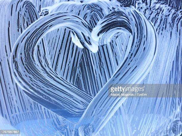 Close-Up Of Heart Shape On Windshield During Carwash