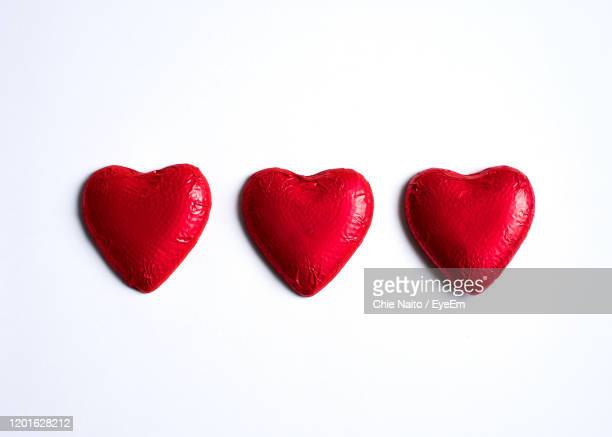 close-up of heart shape over white background - candy heart stock pictures, royalty-free photos & images