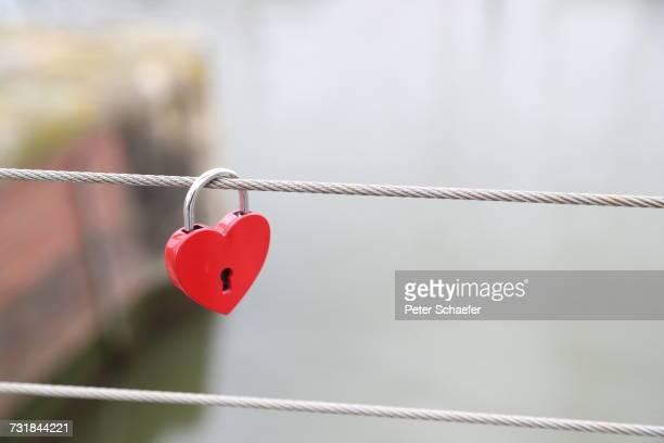 Close-Up Of Heart Shape Padlock On Rope
