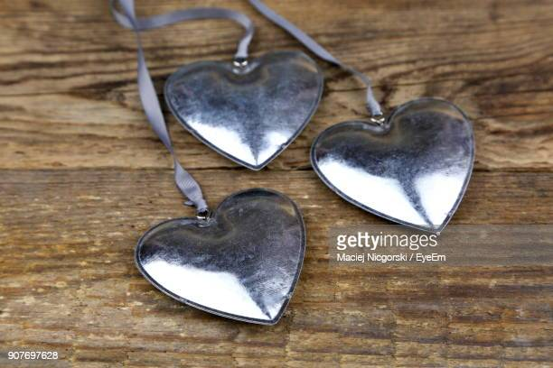 Close-Up Of Heart Shape Pendants On Table
