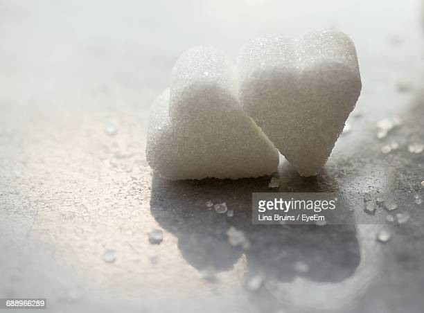 Close-Up Of Heart Shape Sugar Cubes On Marble