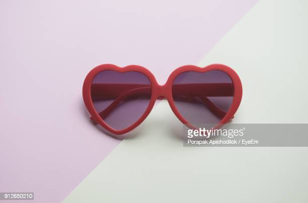 Close-Up Of Heart Shape Sunglasses On Table