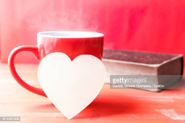 Close-Up Of Heart Shape With Coffee Cup On Table