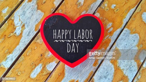 close-up of heart shape with happy labor day text on wood - dia do trabalhador - fotografias e filmes do acervo