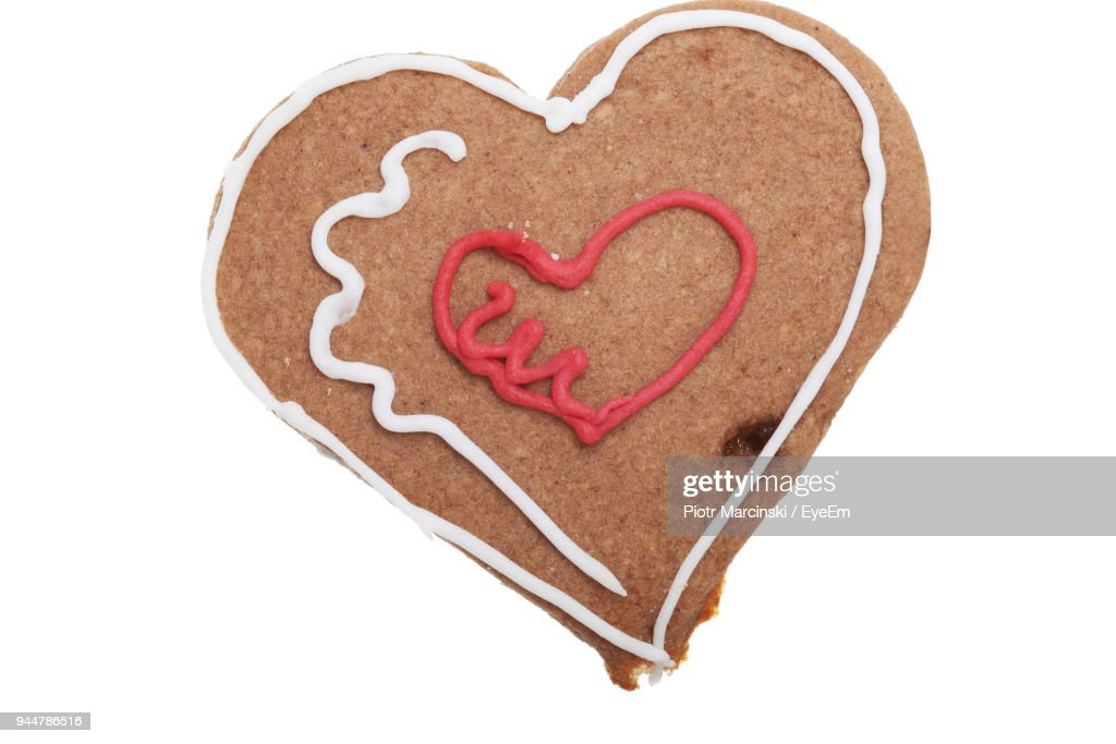 Close-Up Of Heart Shaped Gingerbread Cookie On White Background : Stock Photo