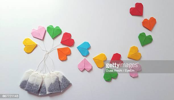 Close-Up Of Heart Shaped Papers