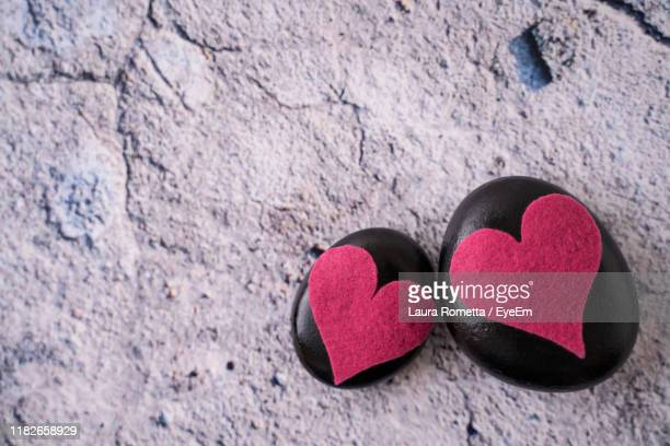 close-up of heart shapes on rocks - perugia stock pictures, royalty-free photos & images
