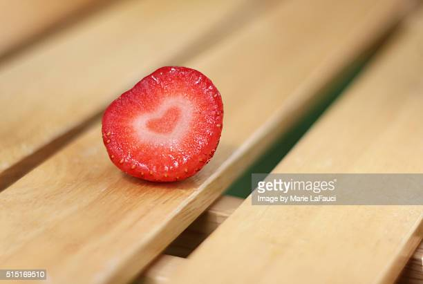 close-up of heart-shaped strawberry - fauci stock pictures, royalty-free photos & images