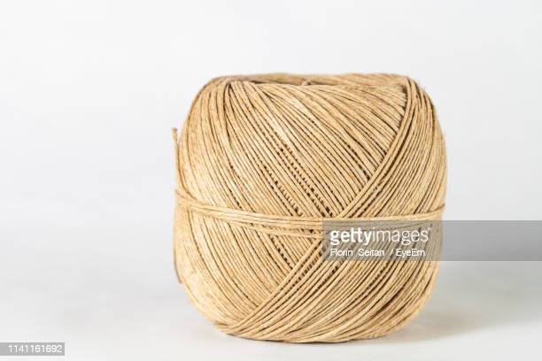 close-up of hemp twine ball against gray background - florin seitan stock pictures, royalty-free photos & images