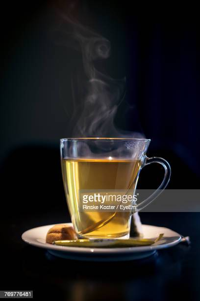 close-up of herbal tea against black background - saucer stock pictures, royalty-free photos & images