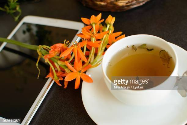 Close-Up Of Herbal Tea And Phone On Table