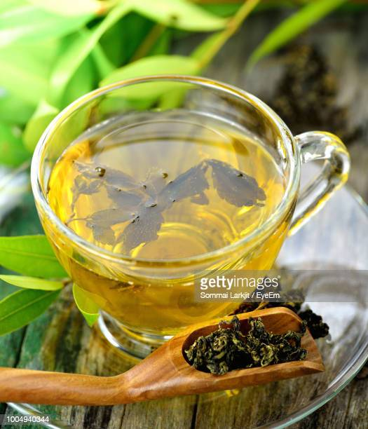 Close-Up Of Herbal Tea In Cup On Saucer Over Table