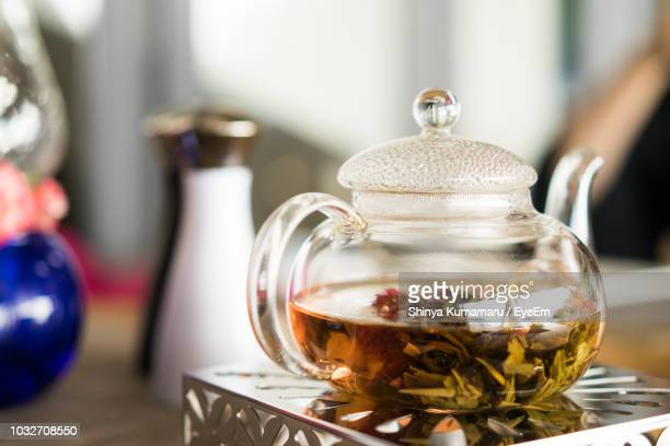 close-up of herbal tea in kettle on table - herbal tea stock pictures, royalty-free photos & images