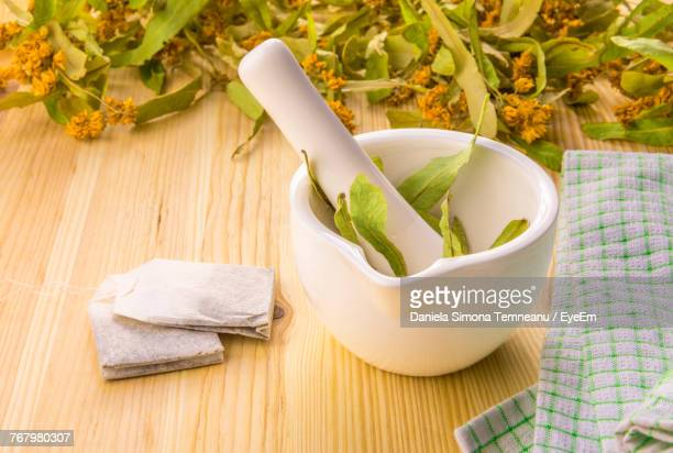 Close-Up Of Herbs In Container On Table
