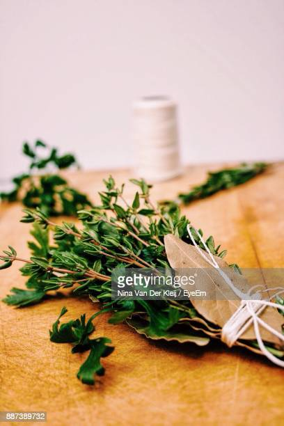 Close-Up Of Herbs On Cutting Board