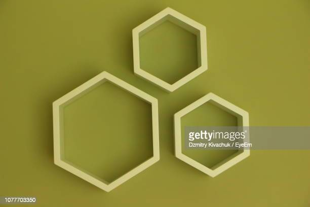 close-up of hexagon shape decoration on green background - honeycomb stock pictures, royalty-free photos & images