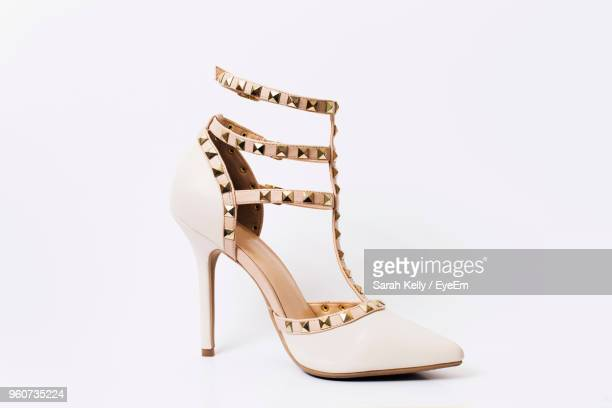 close-up of high heel over white background - talons hauts photos et images de collection
