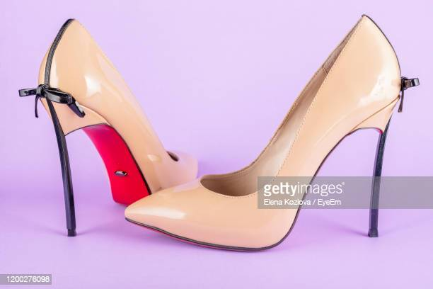 close-up of high heels against pink background - beige shoe stock pictures, royalty-free photos & images