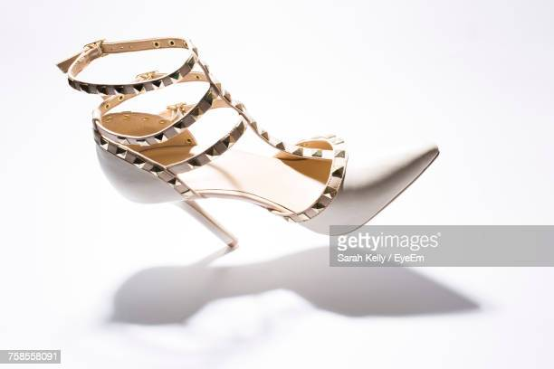 Close-Up Of High Heels Against White Background