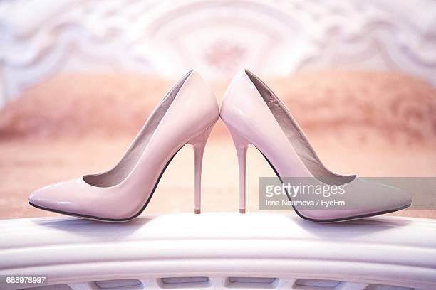 close-up of high heels stilettos on bed at home - pink shoe stock photos and pictures