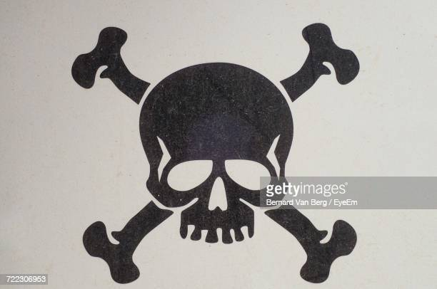 close-up of high voltage sign against white background - skull stock photos and pictures