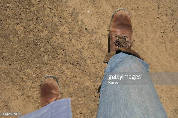 Close-Up Of Hiker Wearing Hiking Boots And Blue Denim Jeans