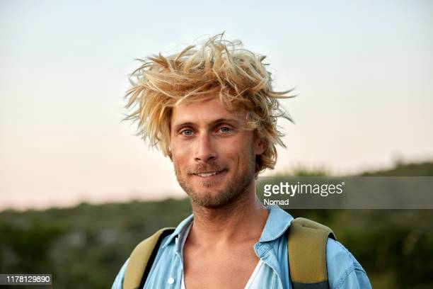 close-up of hiker with messy hair - windswept stock pictures, royalty-free photos & images