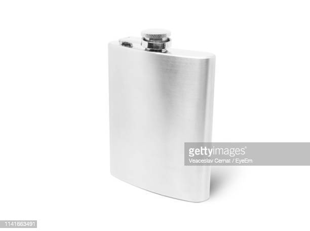 close-up of hip flask against white background - flask stock pictures, royalty-free photos & images