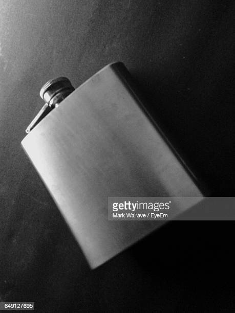 Close-Up Of Hip Flask On Table