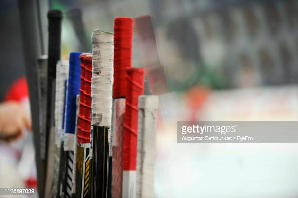 close-up of hockey sticks - hockey stick stock pictures, royalty-free photos & images