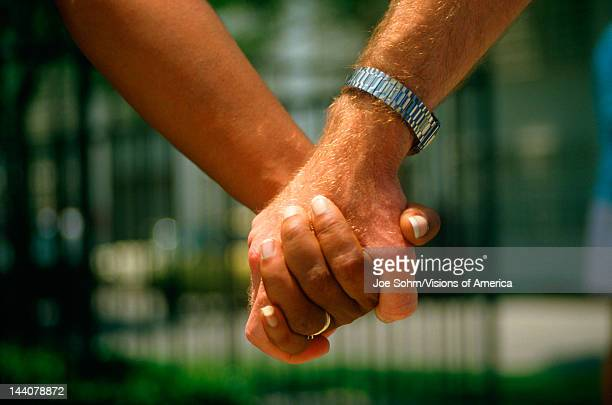 Closeup of holding hands at Hands Across America