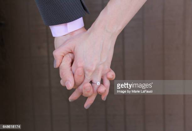 close-up of holding hands - fauci stock pictures, royalty-free photos & images