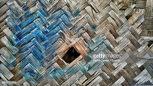 Close-Up Of Hole On Bamboo Wall