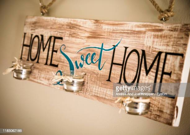 close-up of home sweet home sign - home sweet home stock pictures, royalty-free photos & images