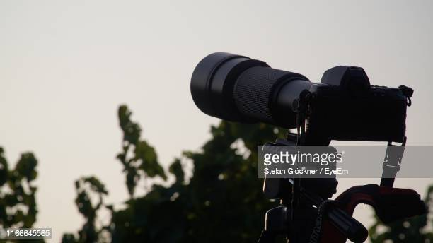 close-up of home video camera against clear sky - camera photographic equipment stock pictures, royalty-free photos & images