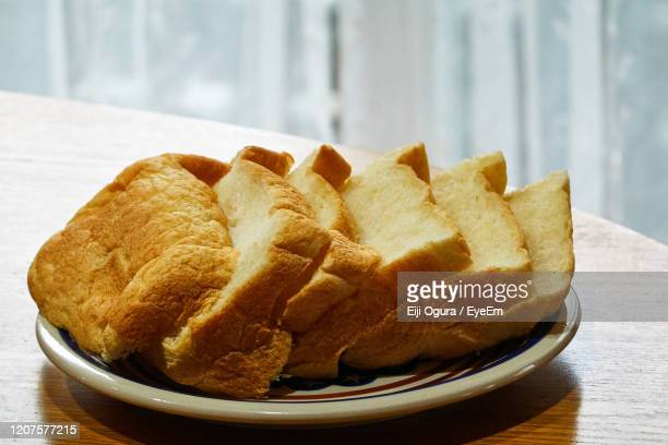close-up of homemade breakfast bread in plate on table - フランス料理 ストックフォトと画像
