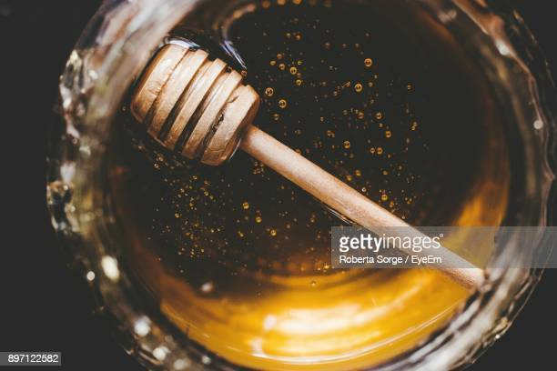 close-up of honey in bowl - honey stock pictures, royalty-free photos & images