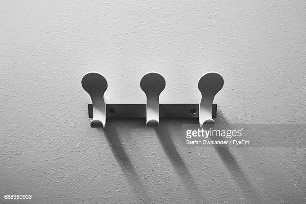 Close-Up Of Hooks Mounted On Wall